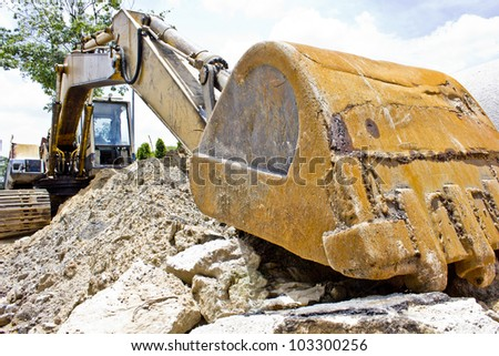 excavator loader machine during works outdoors at construction site