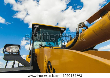 Excavator Loader Machine. Side View of Front Hoe Loader. Industrial Vehicle. Heavy Equipment Machine. Pneumatic Truck. Construction Equipment on a background of blue sky #1090164293