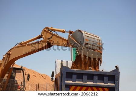 Excavator loading a truck