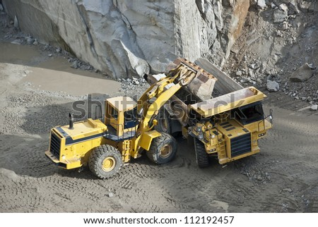 excavator loading granite stones in a quarry Cadalso de los Vidrios in Madrid, Spain