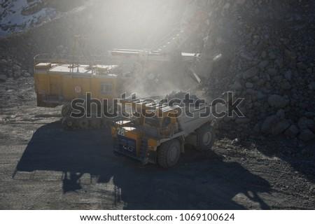 excavator loads ore in the dump ...
