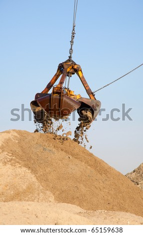 Excavator mounted on a barge on the ground will draw fairway