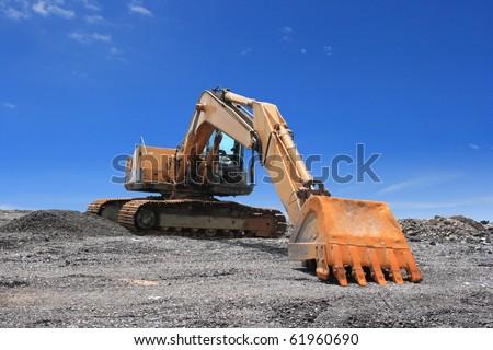 Excavator on blue sky