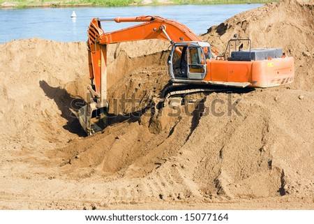 excavator on the beach of the river