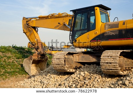 Excavator parked by the construction site
