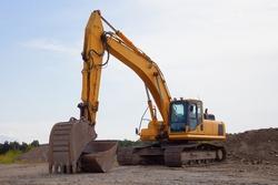 excavator site construction trackhoe heavy machine yellow equipment