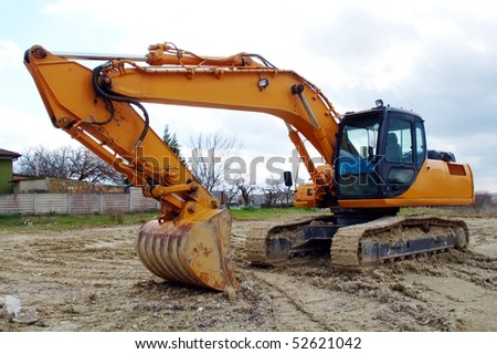 stock-photo-excavator-standing-in-the-construction-site-52621042.jpg