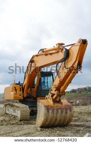 Excavator standing in the construction site