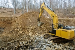 Excavator unload gravel loader with a bucket filled with crushed stone