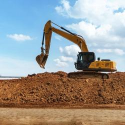 Excavator with blue sky