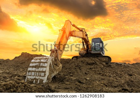 Excavator work on construction site at sunset Foto stock ©