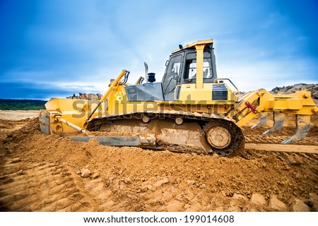 Excavator working and moving earth in construction site, highway road in construction