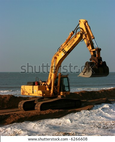 Excavator working on the seaside
