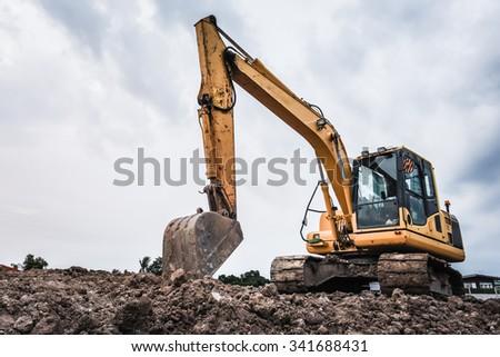 Excavators machine in construction site on sky background
