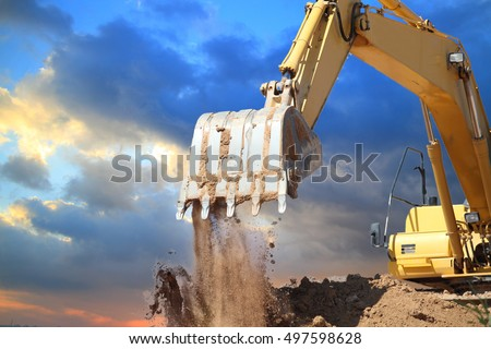 Excavators machine in construction site on sunset background