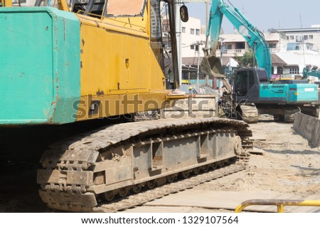 Excavators working at construction site of subway station in Bangkok, excavator is working to construct underground route.