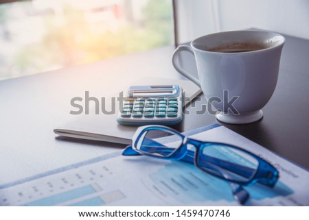 Excel graph with Spreadsheet Document showing Information Financial Startup Concept. Financial Planning making Accounting Database Report. Graphs and chart on screen with stationery set business stuff #1459470746