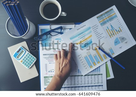 Excel Spreadsheet stats graph analytics data. Accountant hands holding Financial Document Trading Information with excel file. Finance statistic report analyze business graph, chart,database,report. #641609476