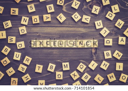 Excellence word wood block on table for business concept. #714101854