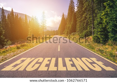 Excellence word written on road in the mountains #1062766571