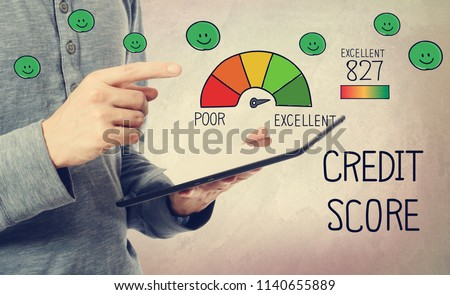 Excellent Credit Score with man holding a tablet computer #1140655889