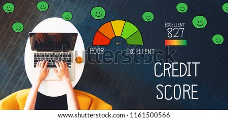 Excellent Credit Score with person using a laptop on a white table