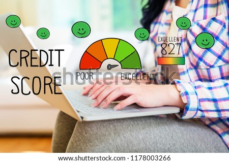 Excellent Credit Score with young woman using a laptop computer #1178003266
