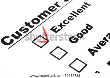 excellent or good marketing customer service survey with red pencil and checkbox