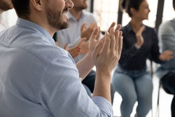 Excellent report! Close up of diverse multiethnic audience millennial men and women sitting on chairs clapping hands to speaker lecturer appreciating for good speech grateful for useful information