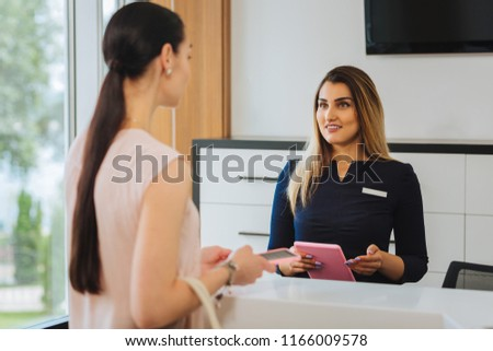 Excellent service. Nice friendly woman talking to the client while standing at the reception