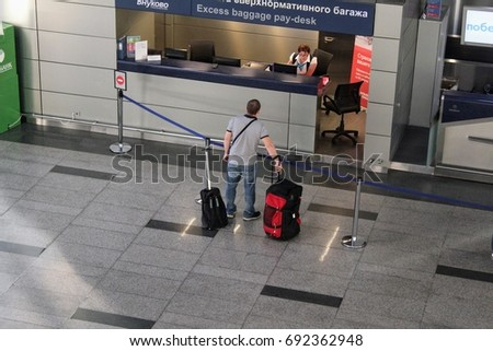 Excess baggage pay-desk at the Vnukovo International Airport (Moscow) - July 2017. #692362948