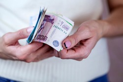 Exchange rates, Very happy girl with rubles in hand, inflation in Russia, pension, apartment payment