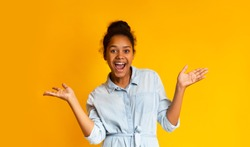 Excited African Teen Girl Screaming Over Yellow Background, Looking At Camera. Panorama with copy space
