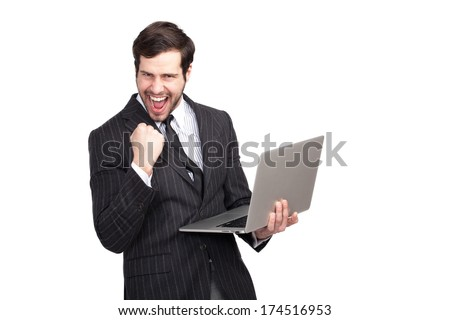 excited and expresive businessman with a latop in his hand showing succes, isolated