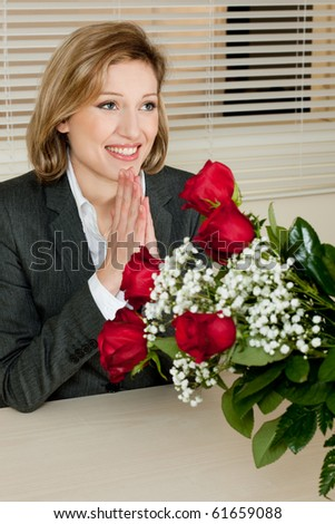Excited and surprised businesswoman receiving red roses - Valentine's day, Birthday or Anniversary