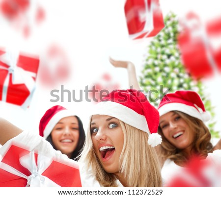 Excited attractive three women with many gift boxes and bags falling down around them