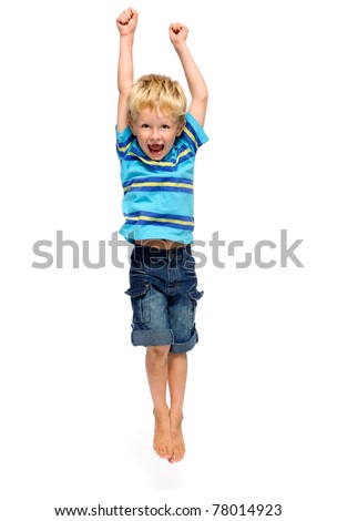 Excited blonde child jumps and throws his arms up