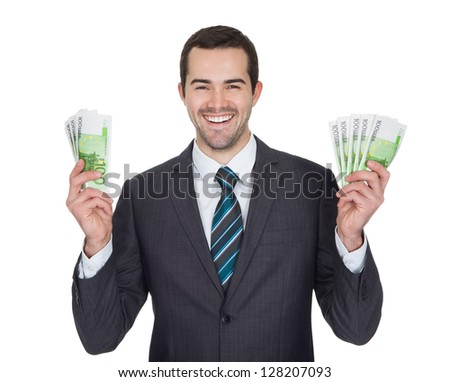Excited businessman holding euro notes. Isolated on white