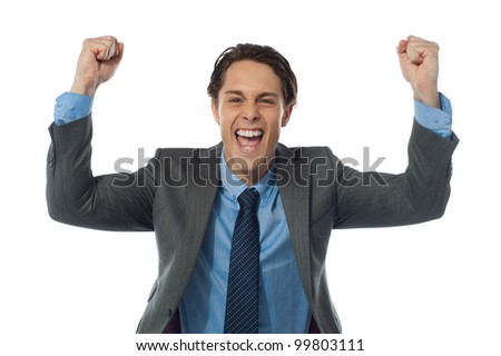 Excited businessman raising his arms and cheering joyfully. Isolated on white