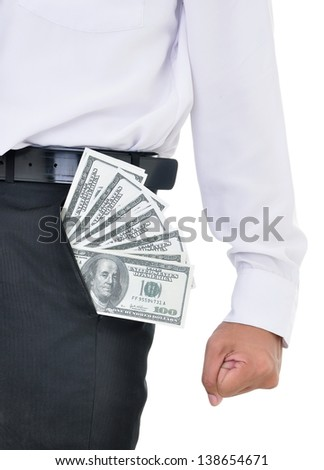 Excited businessman with lots of American dollars in the pocket, isolated on white background