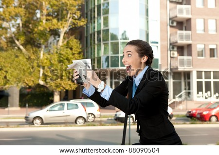 excited businesswoman with newspaper, excellent news