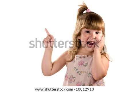 Excited child looking at you pointing up with laugh isolated on white