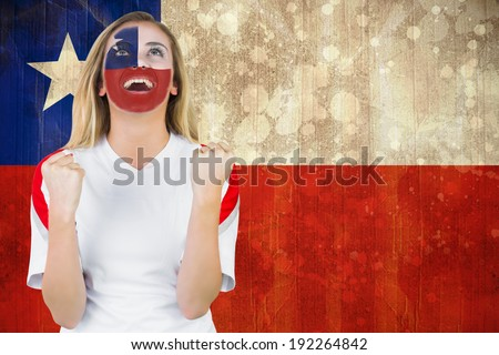 Excited chile fan in face paint cheering against chile flag in grunge effect