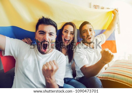 Excited colombian soccer fans celebrating to camera