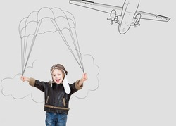 Excited cute parachutist girl toddler with drawn parachute. Profession concept collection.