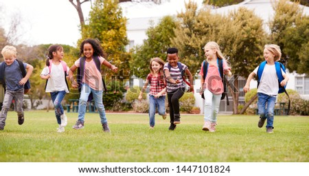 Excited Elementary School Pupils Running Across Field At Break Time #1447101824