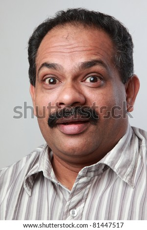 Excited face of a middle aged Indian male