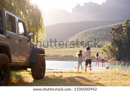 Excited Family Reaching Countryside Destination On Road Trip