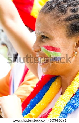 excited female sports fan watching a game