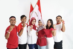 excited friend raised arm on indonesian independence day celebration on white background